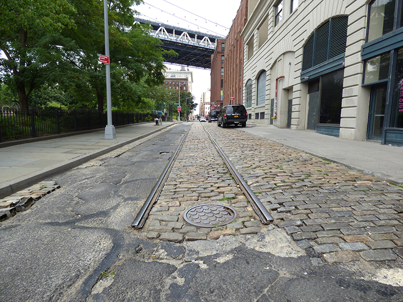 A new report issued by the Historic District Council outlines ways to preserve DUMBO's unique Belgian block streets while complying with the mandate to make them assessable. Photo by Mary Frost