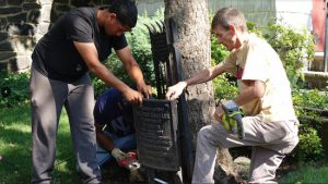 Crew working with the Episcopal Diocese of Long Island saw into one of the plaques commemorating Robert E. Lee. Photo: Episcopal Diocese of Long Island. Photos: Episcopal Diocese of Long Island.