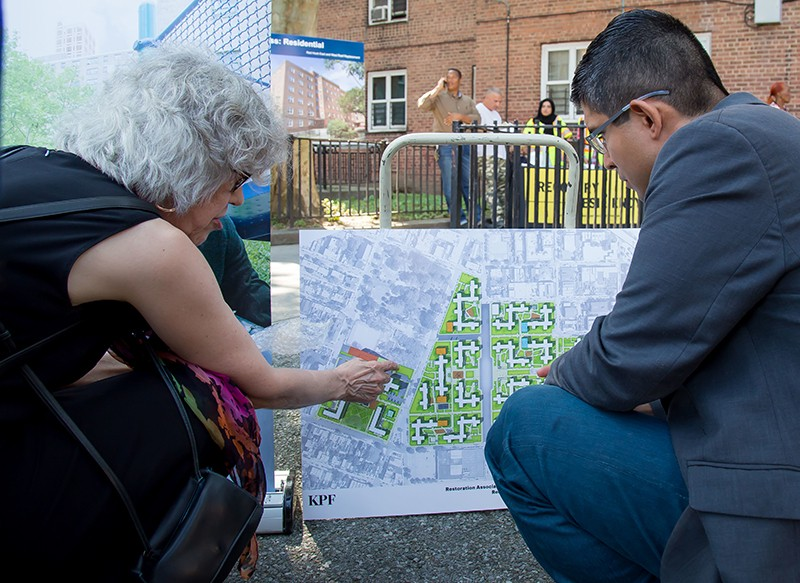 City Councilmember Carlos Menchaca looks over the plans with a constituent