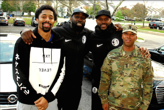 (L-R) Brooklyn Nets players Spencer Dinwiddie, Quincy Acy and Trevor Booker with Command Sergeant Major Javier Lugo with the Joint Task Force Empire Shield of the New York National Guard. Brooklyn Eagle photos by Arthur De Gaeta