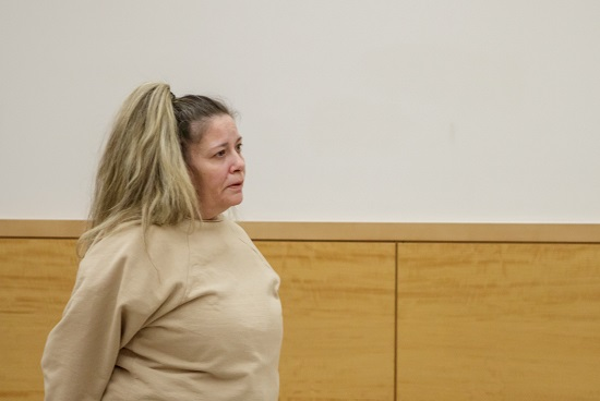 Rosemarie Bader appears in Brooklyn Supreme Court to be sentenced for grand larceny. Eagle photo by Paul Frangipane