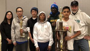 The chess team at Brooklyn's Edward R. Murrow High School is getting ready to go to the state chess championships, where the school hopes to reclaim the NYS title. From left: Samantha Dong, Steven Xue, Wang Chan, Justin Dalhouse, Marcus Sutton, Anthony Saquisili and coach Eliot Weiss. Photo courtesy Edward R. Murrow HS