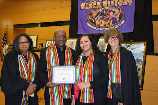 As part of the Brooklyn Family Court's Black History Month celebration it honored Ivey Joe Paige, who led the band in a thrilling musical performance. Pictured (from left) are Hon. Jacqueline D. Williams; Ivey Joe Paige; Nesta Johnson; and Hon. Amanda White, supervising judge of the Kings County Family Court. Eagle photos by Rob Abruzzese