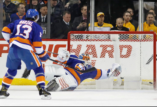 Jaroslav Halak just missed Roman Josi's game-winning goal in overtime Monday night at Barclays Center as the Islanders suffered a grueling 5-4 loss to the defending Western Conference champion Nashville Predators. AP Photo by Kathy Willens