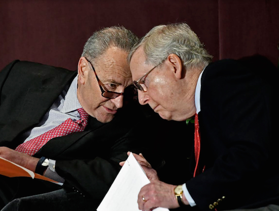 Sen. Chuck Schumer (left) and Sen. Mitch McConnell went head-to-head on Monday over which of their hometowns boasts the best bourbon. AP Photo/Timothy D. Easley