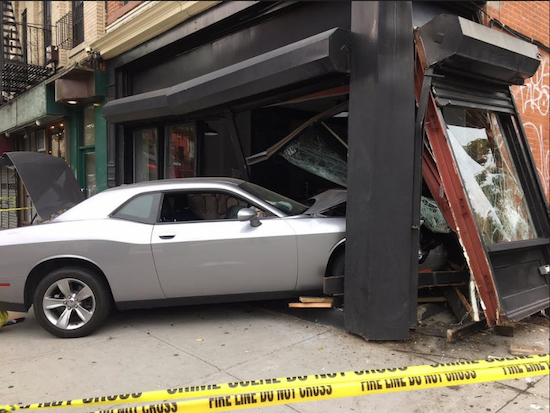 Image of the Dodge Challenger that swerved into the Cafe, sending two people to the hospital. Photos courtesy of FDNY