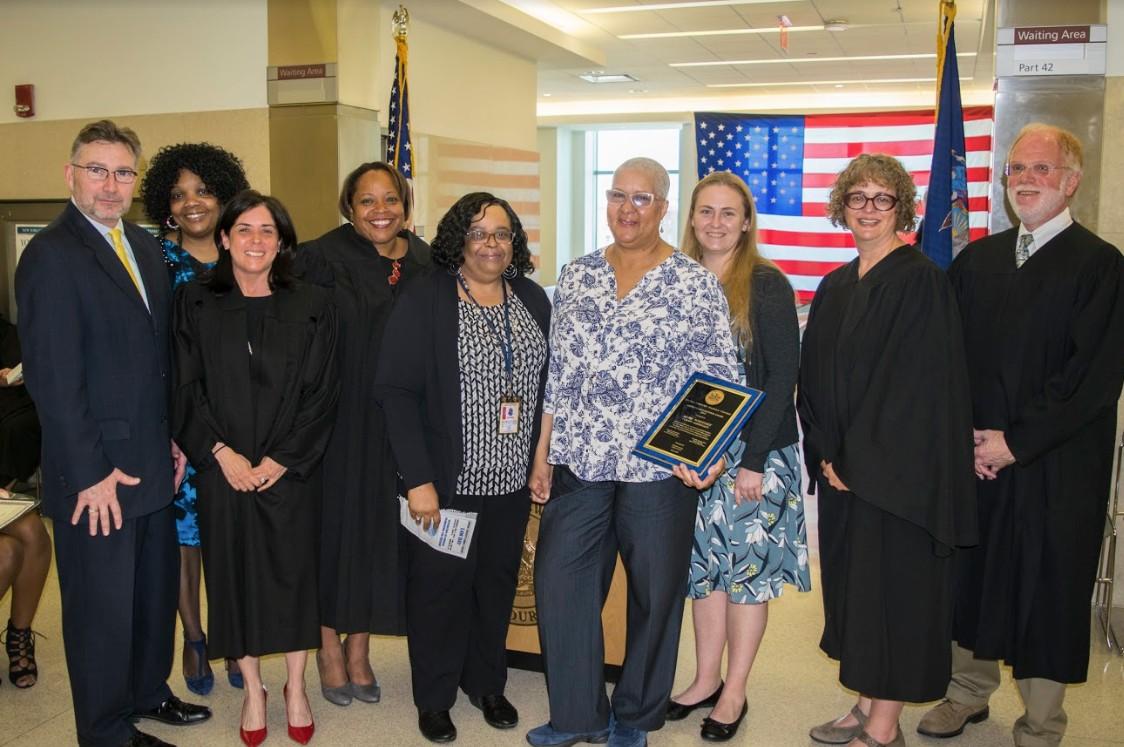 From left: John Coakley, Dionne Lowery, Hon. Alicea Elloras, Hon. Anne-Marie Jolly, Kathy Allen, honoree Lori L. Whitney, Erin Heslin, Hon. Amanda White and Hon. Alan Beckoff.