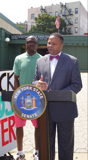 "State Sen. Jesse Hamilton (at podium) says recent 911 calls reporting African-Americans ""are acts of intimidation."" Photo courtesy of State Sen. Jesse Hamilton's campaign"