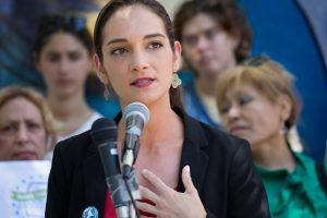 Julia Salazar will appear on the ballot for the Democratic primary for District 18's state Senate seat after Brooklyn Judge Edgar Walker rejected state Sen. Martin Dilan's lawsuit that she hasn't lived in the state long enough. Photo by Kyle Depew/Courtesy of Julia Salazar
