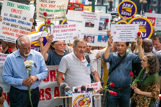 A cab driver outside City Hall spoke to a crowd rallying in favor of the new regulations. Photos by Anurag Papolu