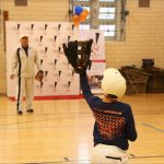 The former NY Mets second baseman played catch with a student during his visit to the after-school program. Photos courtesy of Queens Community House