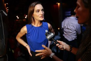Julia Salazar, left, answers questions during an interview after winning the Democratic primary over Martin Dilan in New York's 18th State Senate district race on Thursday. AP Photo/Julie Jacobson