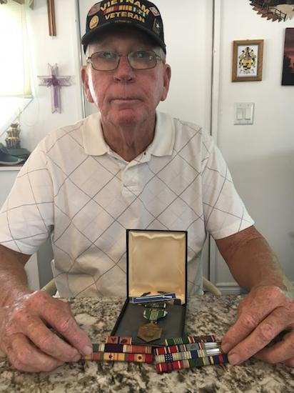 Gary Farris holding the medals belonging to Brooklyn Vietnam serviceman James J. Brennan. Photos courtesy of Gary Farris