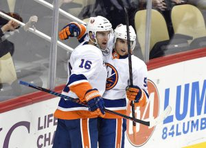 New York Islanders left wing Andrew Ladd (16) celebrates with New York Islanders center Valtteri Filppula (51) after scoring a goal against the Pittsburgh Penguins during the first period of an NHL hockey game in Pittsburgh, Tuesday, Oct. 30, 2018. AP Photo/Don Wright