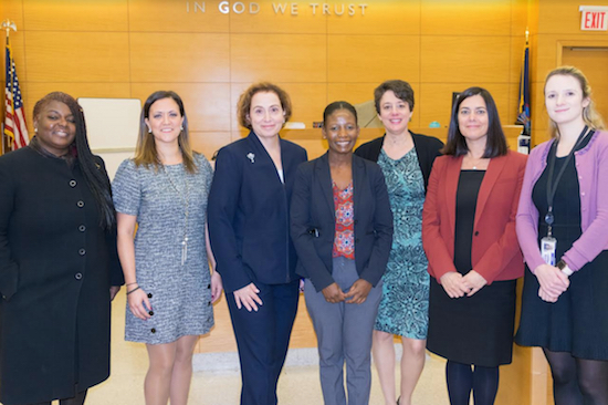 The Kings County Supreme Court's Gender Fairness Committee held an event this month to raise awareness of the risks and dangers of Alzheimer's disease. Pictured is the committee (from left): Hon. Claudia DePeyster, Margherita Racanelli, Hon. Miriam Cyrulnik, Eve Vaval, Hon. Dineen Riviezzo, Coleen Morris and Kate Belsito (not pictured is Armena Gayle). Eagle photos by Rob Abruzzes