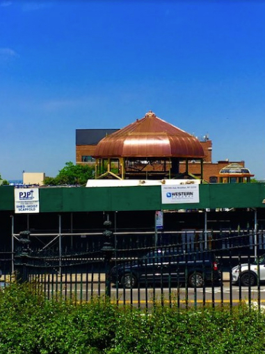 That's the Weir Greenhouse's new copper dome peeking over a construction fence. Eagle file photo by Lore Croghan