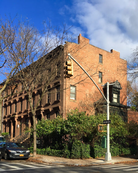 A block from The Cobble Hill House, landmarked brownstones grace the corner of Henry and Congress streets.