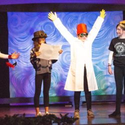 Time travelers Delilah Leykam, Vida DeLeon, Cate Healey (wearing white lab coat and red hat) and Amanda Pieper shoot for the future but wind up in the past. Eagle photo by Francesca N. Tate
