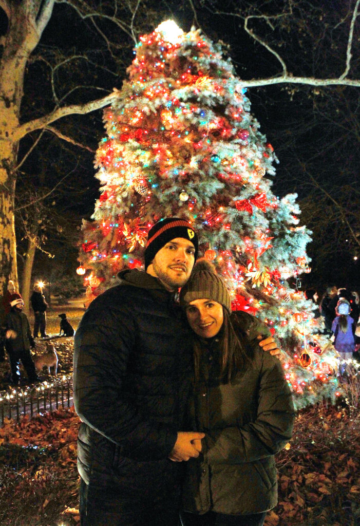 Eric and Erika Landa in front of the lit tree. Photo By Steve Solomonson