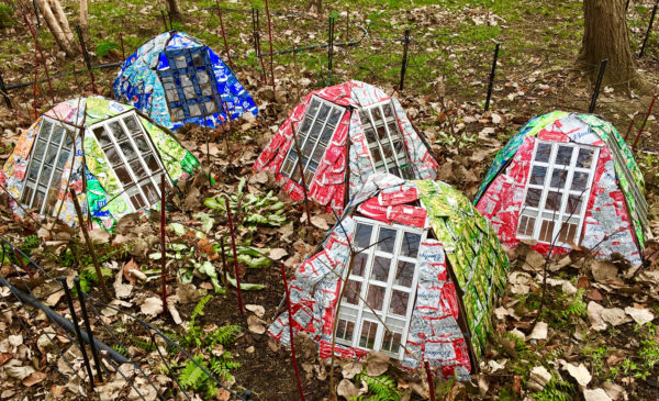"These structures covered with flattened aluminum cans are part of artist Ronen Gamil's work ""Home(-) and Garden"" at Socrates Sculpture Park."