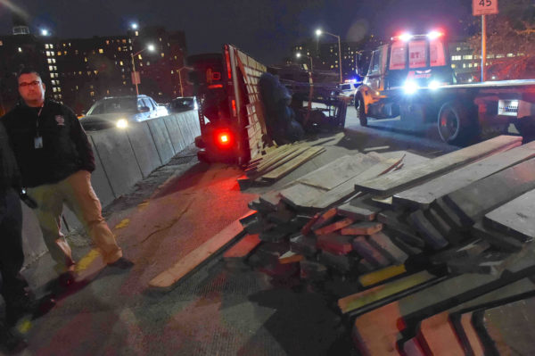 Scores of wooden planks used for scaffolding were scattered across the BQE