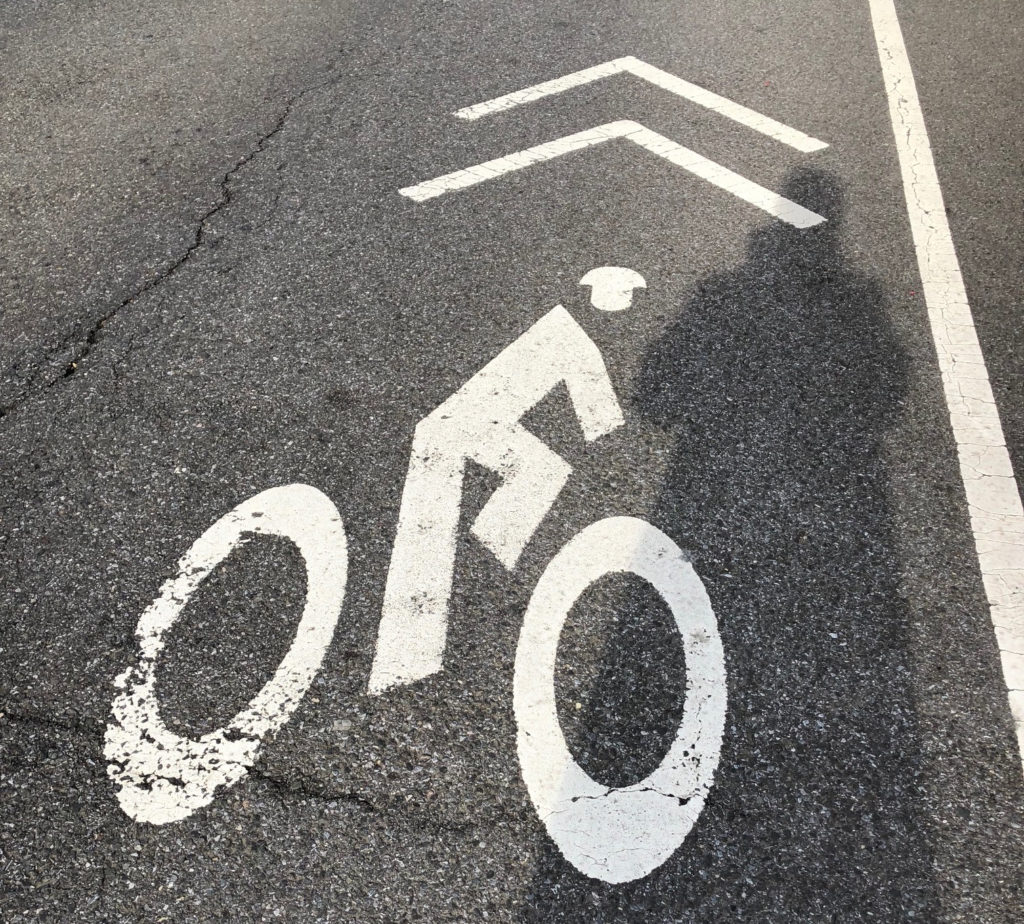 Transportation Alternatives leaders charge that there aren't enough protected bike lanes in New York City. The bike lane logo pictured is located on the roadway on Sixth Avenue near 74th Street and is unprotected. Eagle photo by Paula Katinas