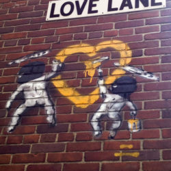 Rascally street Cupids surreptitiously graffiti a Valentine's heart on a wall in Brooklyn Heights bearing the street name Love Lane. Eagle file photo by Lore Croghan