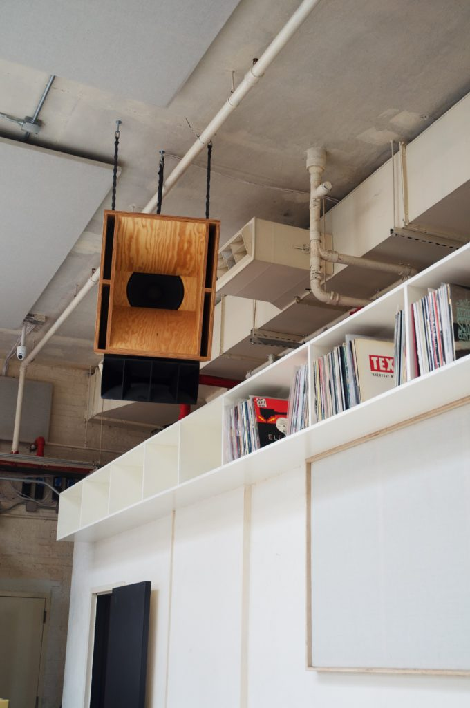 Vinyl records line shelves just below the rafters. Eagle photo by Via Wohl.