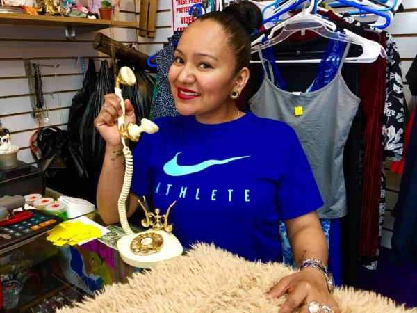 Vintage co-owner Deysi Flores holds a French princess-style phone. Eagle photo by Lore Croghan