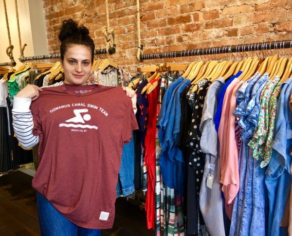 Malvina Kola holds a popular T-shirt at Something Else on Fifth. Eagle photo by Lore Croghan