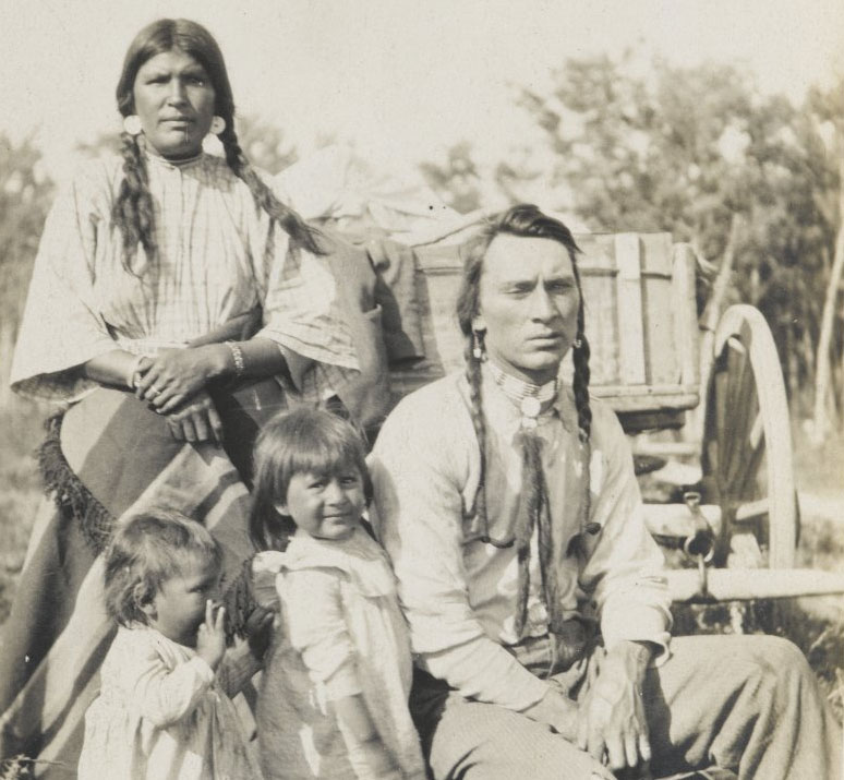 A Native American family poses for a portrait around 1900. Photo via Brooklyn Museum