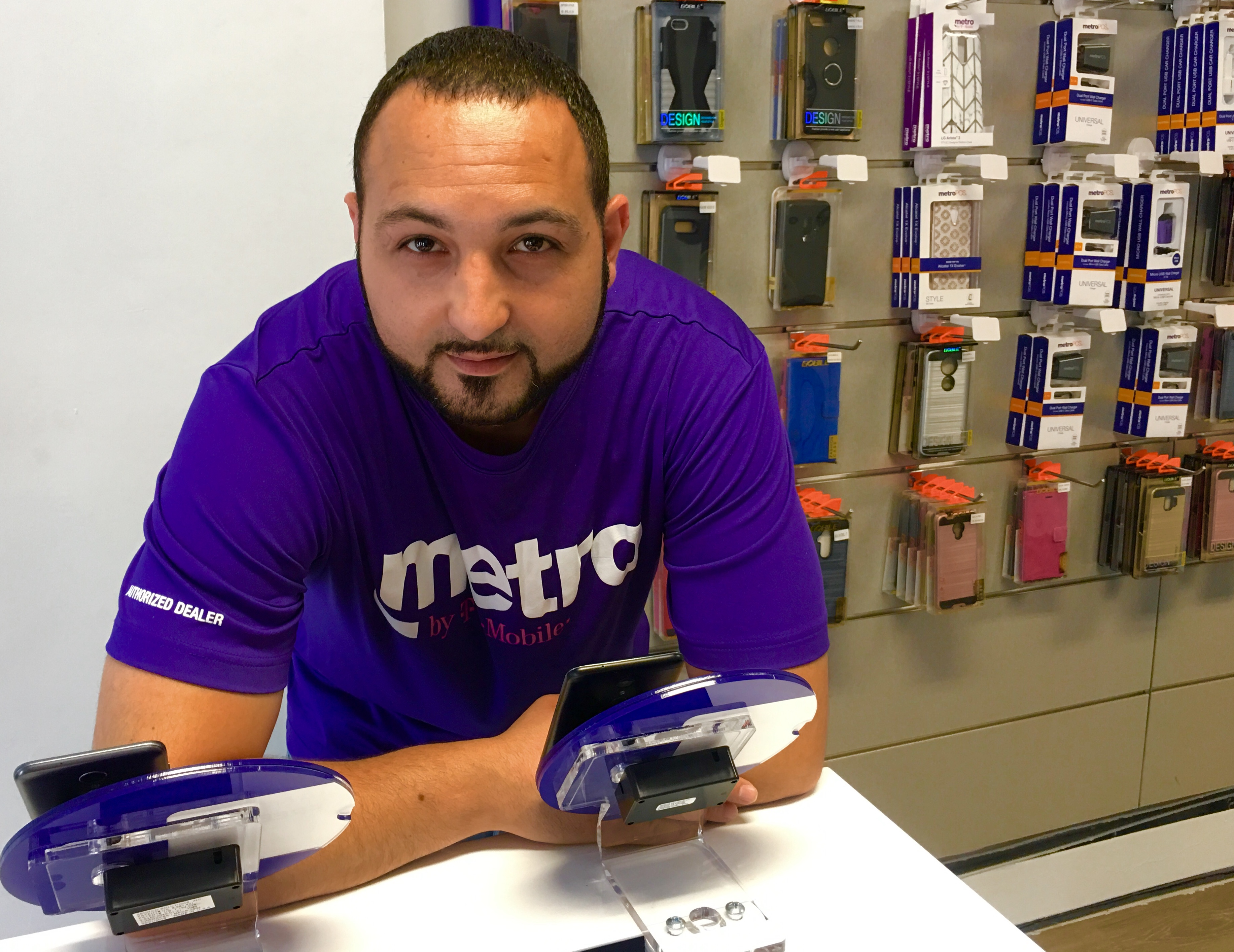 Antar Asad is the manager of Metro by T-Mobile on Church Avenue. Eagle photo by Lore Croghan
