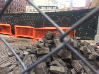 DUMBO Neighborhood Association showed this photo, taken on Adams Street in May, to the Landmarks Preservation Commission as an example of the lack of care taken with the preservation of Belgium block during street work. Photo by Octavio Molina