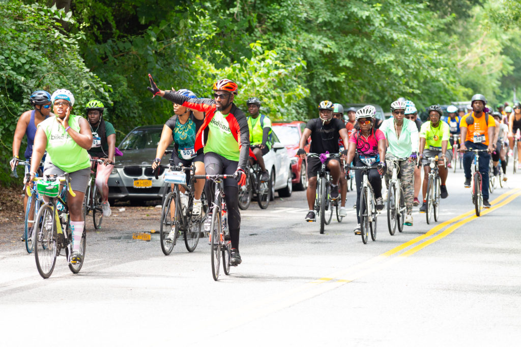 Kevin Joseph (center) leads a group on a bike tour. Photo courtesy of Kevin Joseph