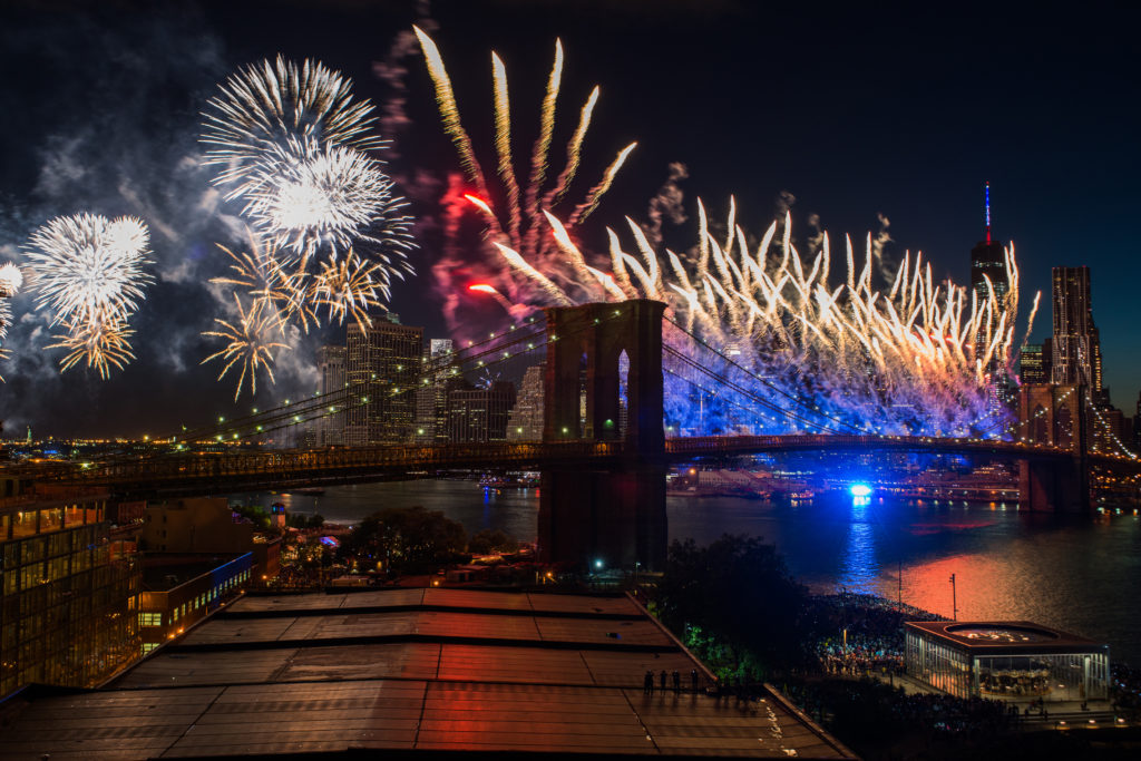 Fireworks are set off from the Brooklyn Bridge. Photo by Julienne Schaer