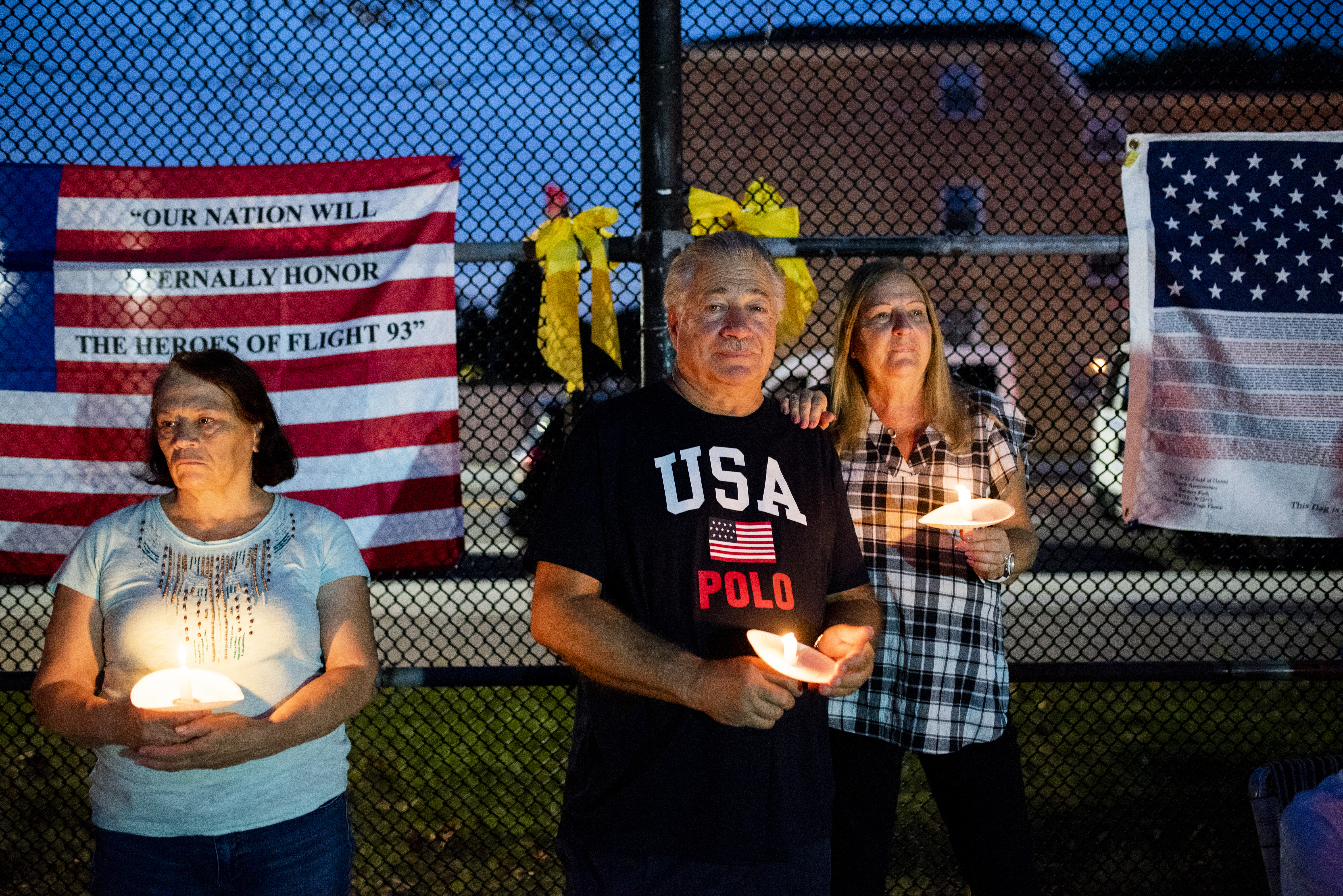 Somber faces are etched with grief at Sheepshead Bay's commemoration of the 18th anniversary of 9/11. Eagle photo by Mark Davis