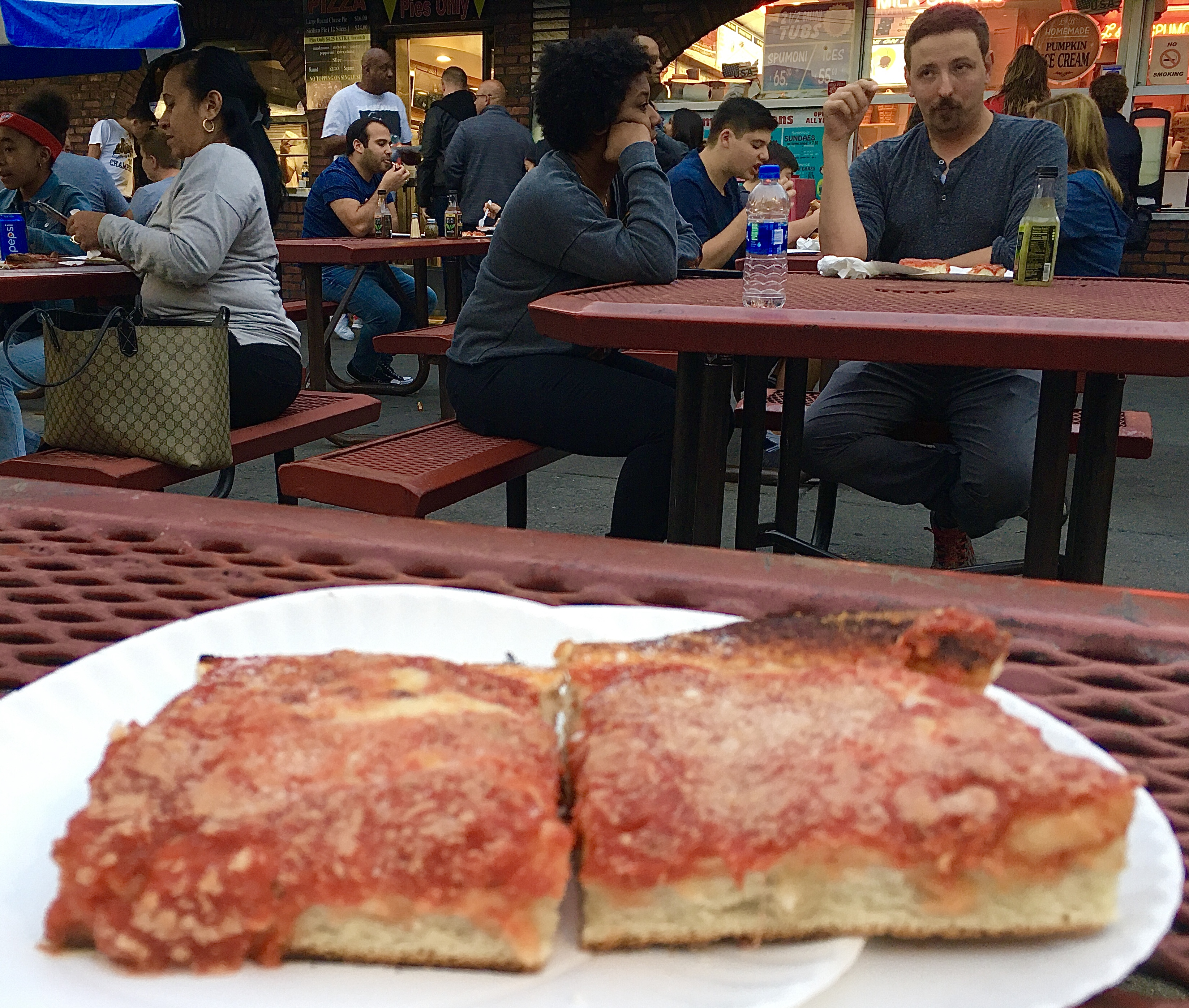 The pizza draws locals and tourists to L&B Spumoni Gardens. Eagle photo by Lore Croghan