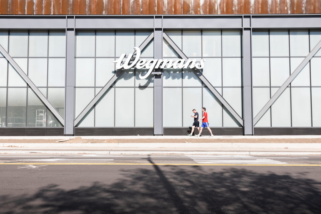 The Wegmans name looms large on the new store's Flushing Avenue facade. Eagle photo by Paul Frangipane