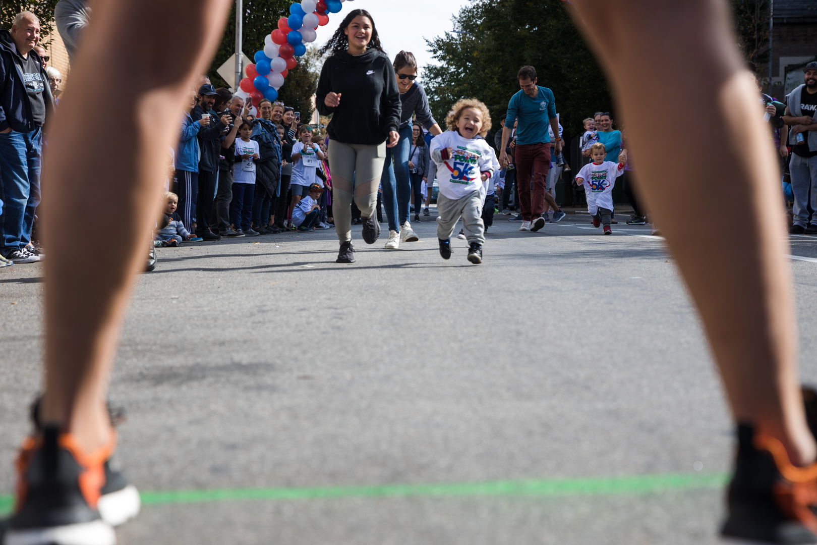 A little girl makes her way to the finish line in a dash. Eagle photo by Paul Frangipane