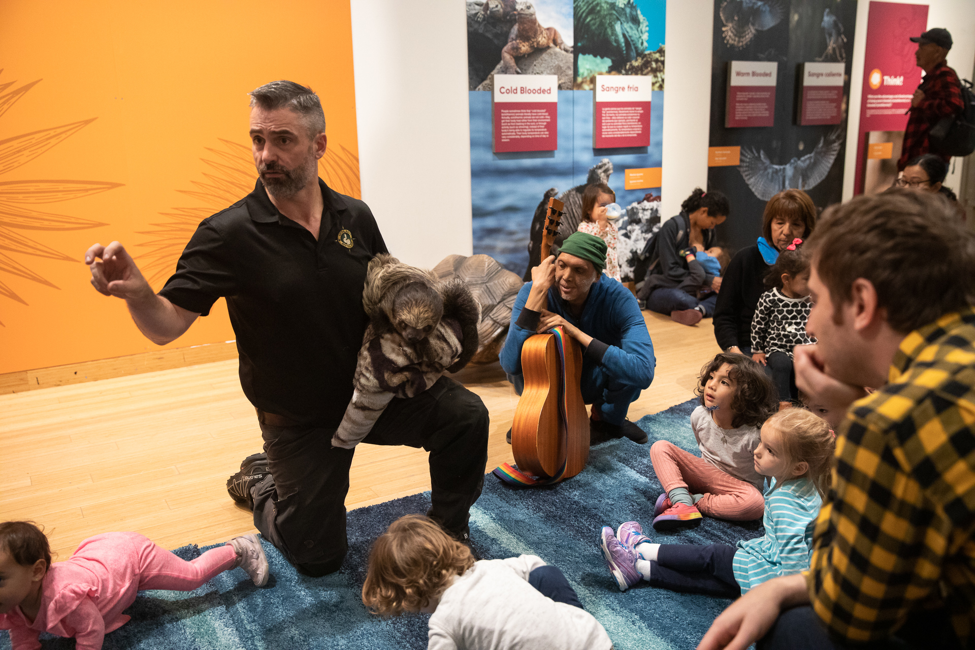 Paul Raymond Goulet of Little Ray's Nature Centres introduces Roger the Sloth to Brooklyn Children's Museum visitors. Eagle photo by Paul Frangipane