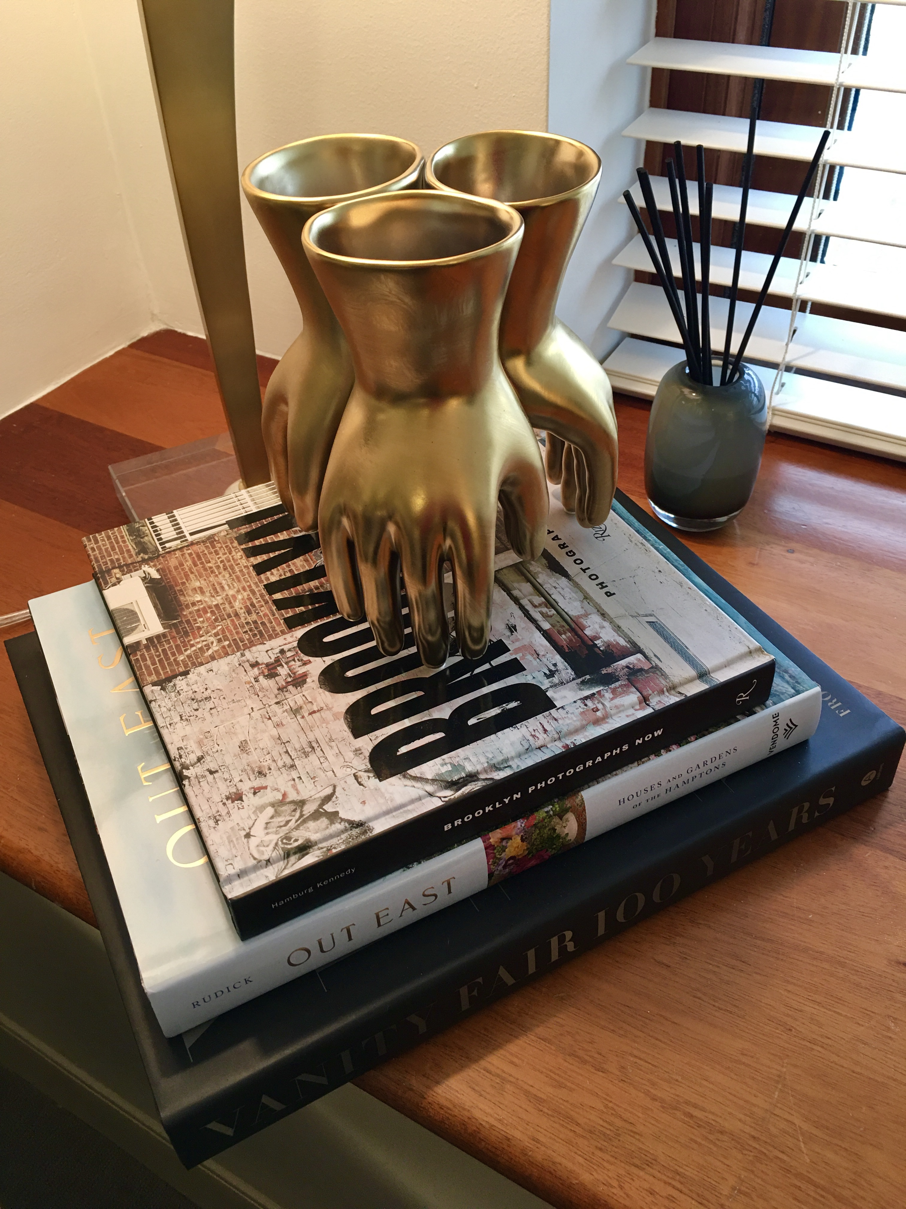 An inviting stack of books is in this Watermark model apartment. Eagle photo by Lore Croghan