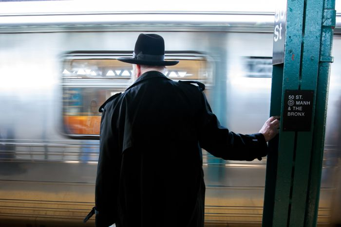An Orthodox Jewish man waits for a D train in Borough Park, Brooklyn on Nov. 4, 2019 Photo: by Ben Fractenberg/THE CITY