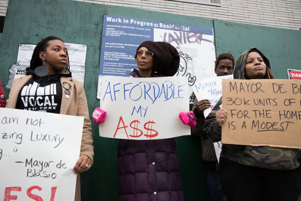Housing advocates gathered outside 348 Nostrand Ave. to demand the city offer truly affordable housing and units for homeless New Yorkers. Photo: Paul Frangipane/Brooklyn Eagle