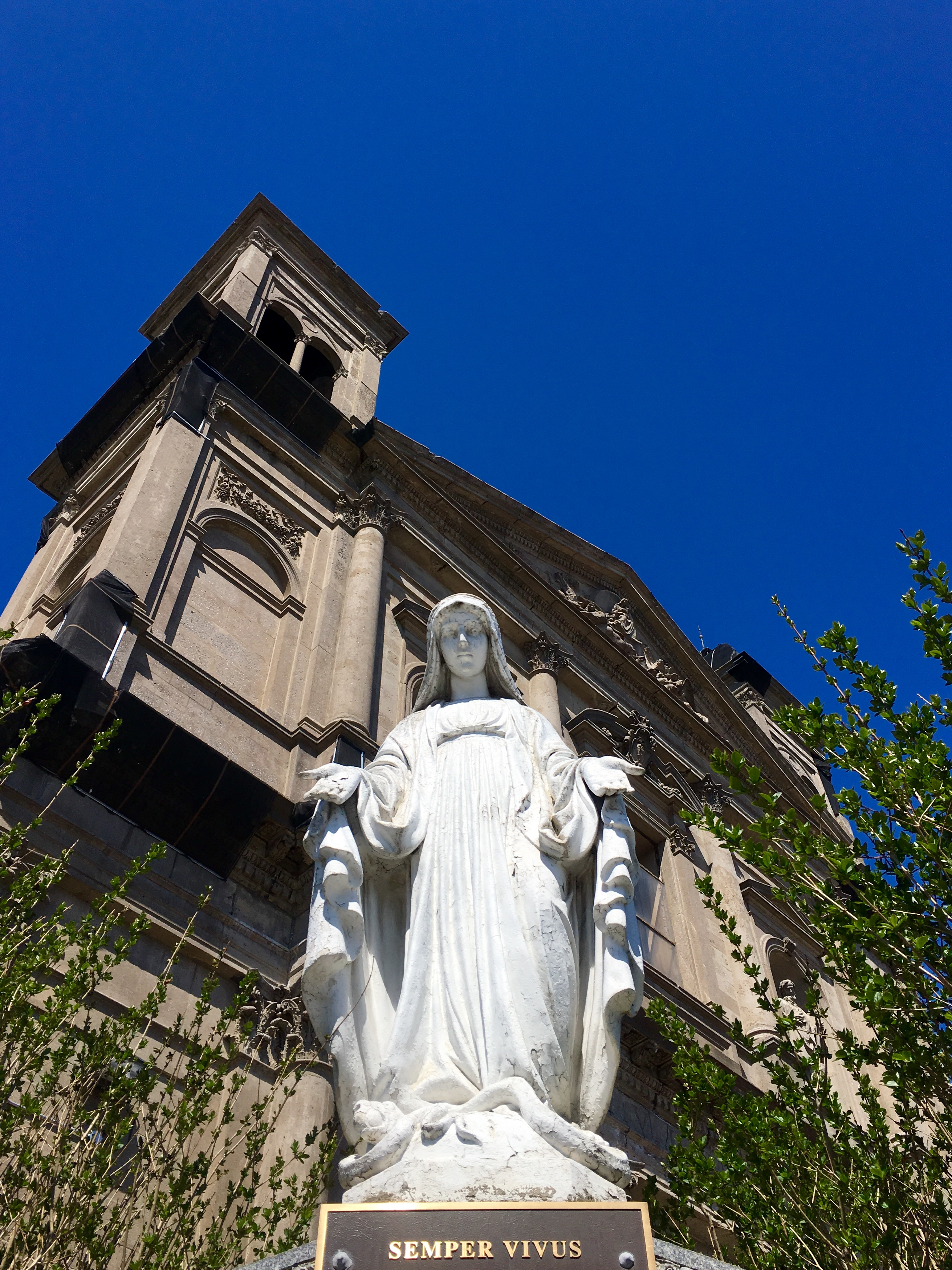 A statue of the Blessed Mother stands outside Our Lady of Loreto Church in this 2016 photo. Photo: Lore Croghan/Brooklyn Eagle