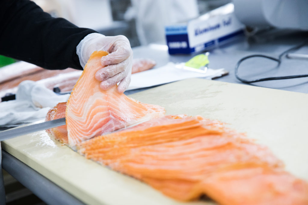 It takes months to learn how to hand-slice salmon. Photo: Paul Frangipane/Brooklyn Eagle