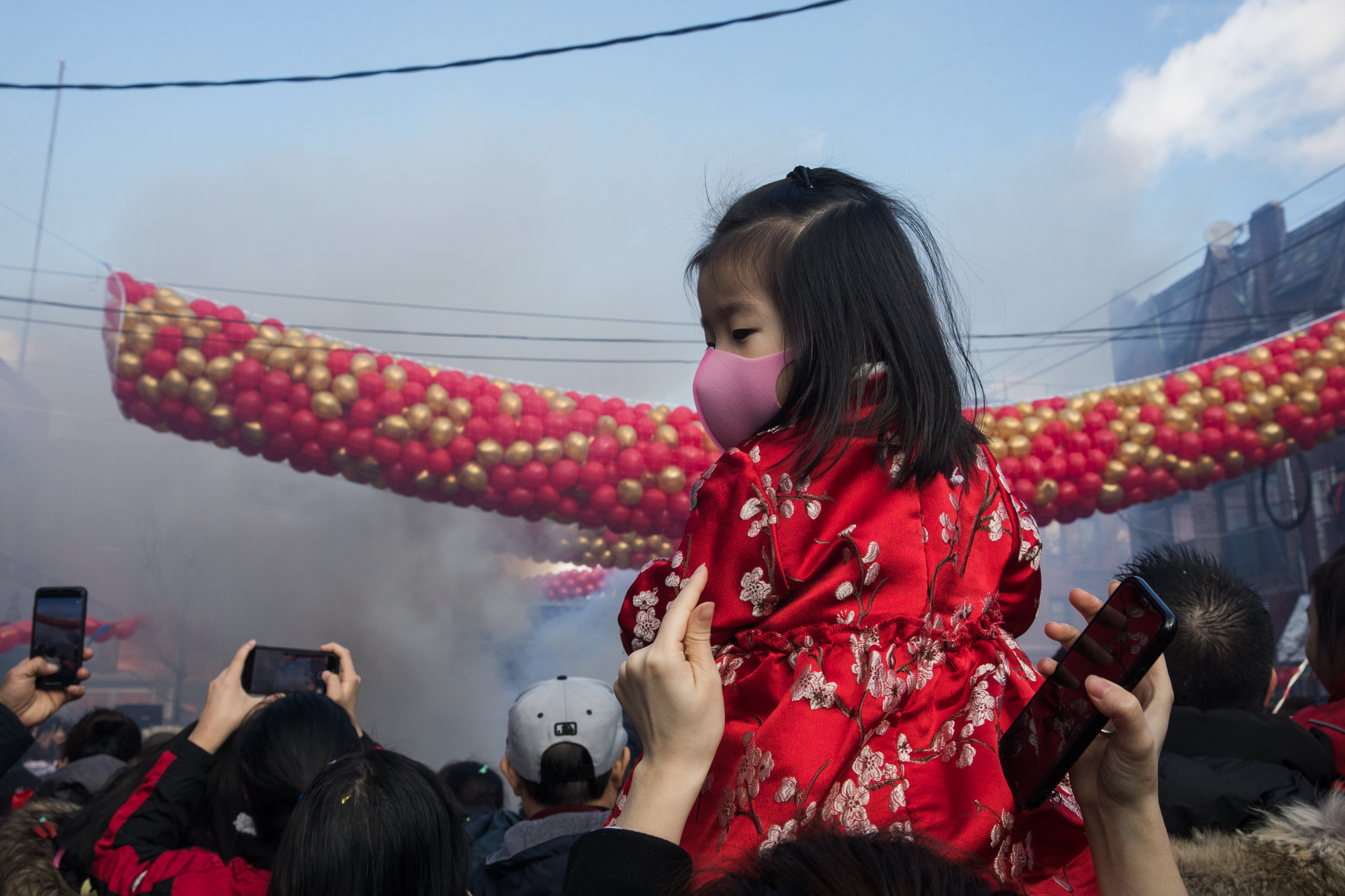 The crowd tightly packed together to watch the firecracker display and balloon drop.