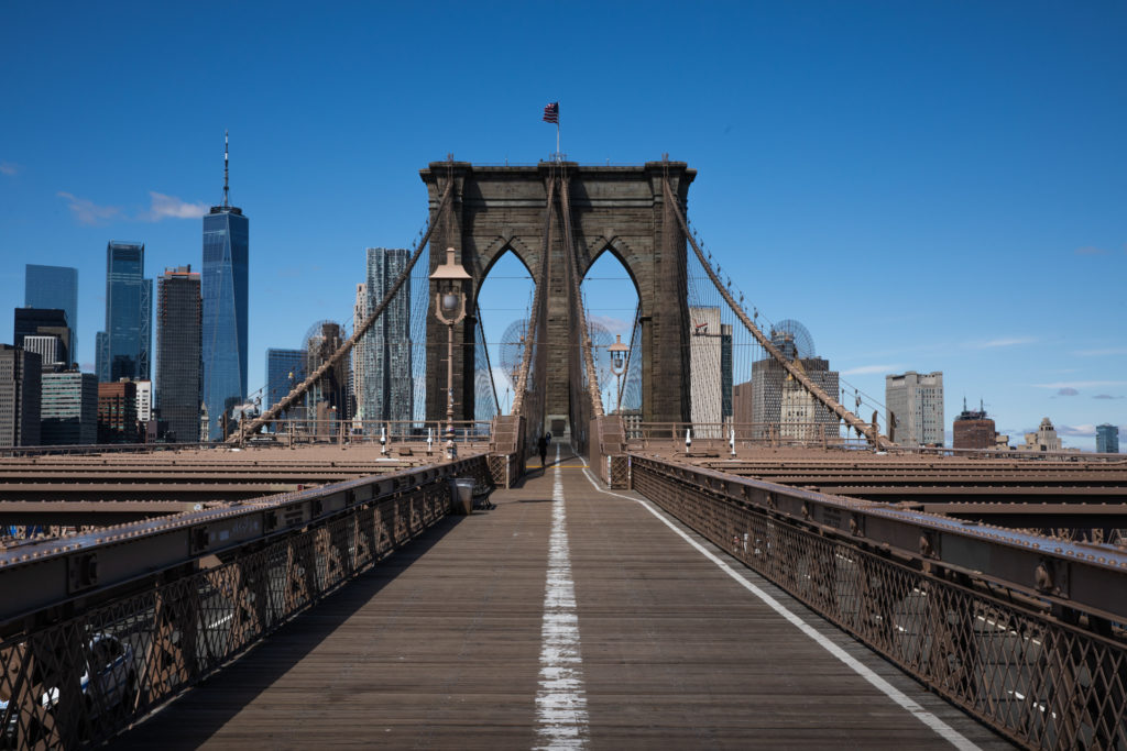 The Brooklyn Bridge walkway and bike path is almost completely empty on the Brooklyn side a little after noon on March 24, 2020. Photo: Paul Frangipane/Brooklyn Eagle