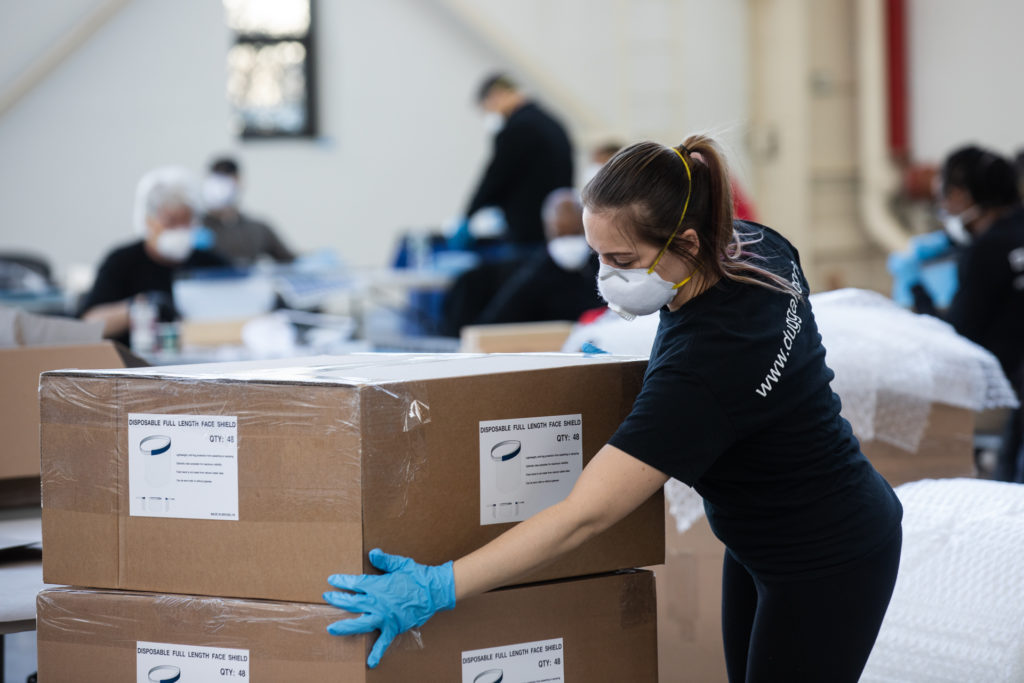 Industrial firms Duggal Visual Solutions and Bednark are using their spaces in the Brooklyn Navy Yard to manufacture personal protective equipment for local hospitals. Company workers built face shields in the warehouse on March 26, 2020. Photo: Paul Frangipane/Brooklyn Eagle